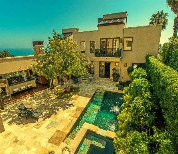 Beautiful Outdoor View of Waterfront Mansion with Pool