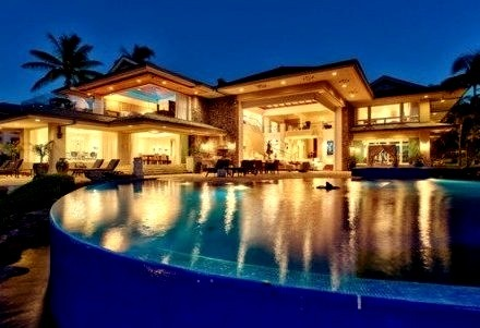 Night time Mansion and Pool Lit Up