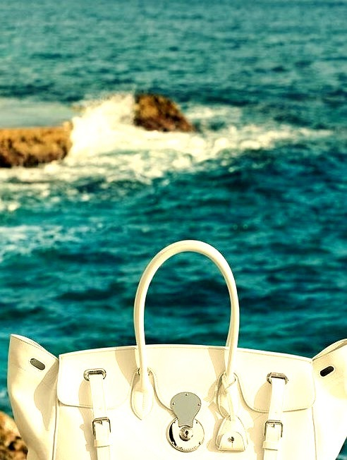 White Ralph Lauren Fashion Bag Infront of the Ocean