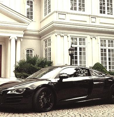 Audi Outside of Mansion